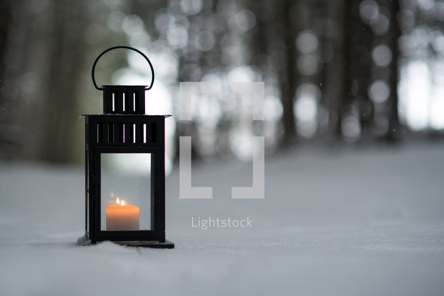 a lantern in the snow