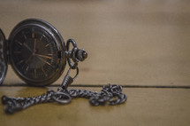 pocket watch on a table