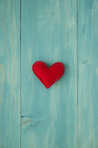 felt heart on teal wood background