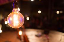 glowing hanging lightbulb