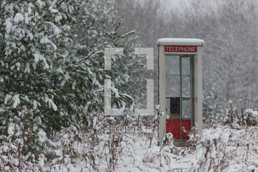 snow on a telephone booth