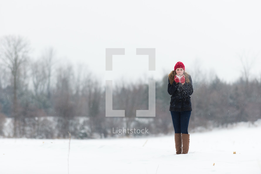 a teen girl playing in the snow