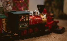 Christmas toy train around a Christmas tree
