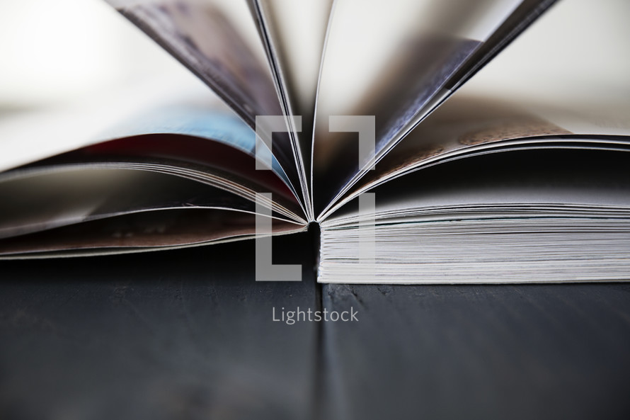 flipping through pages of a magazine