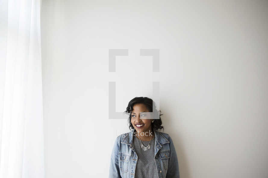 An African American woman in a jean jacket