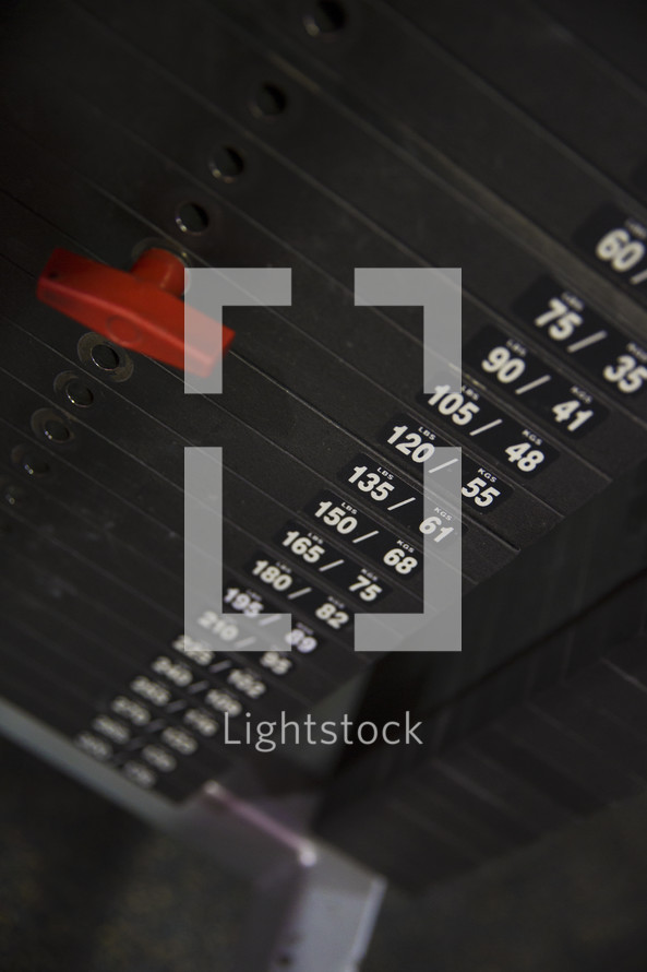 weights on fitness equipment at the gym