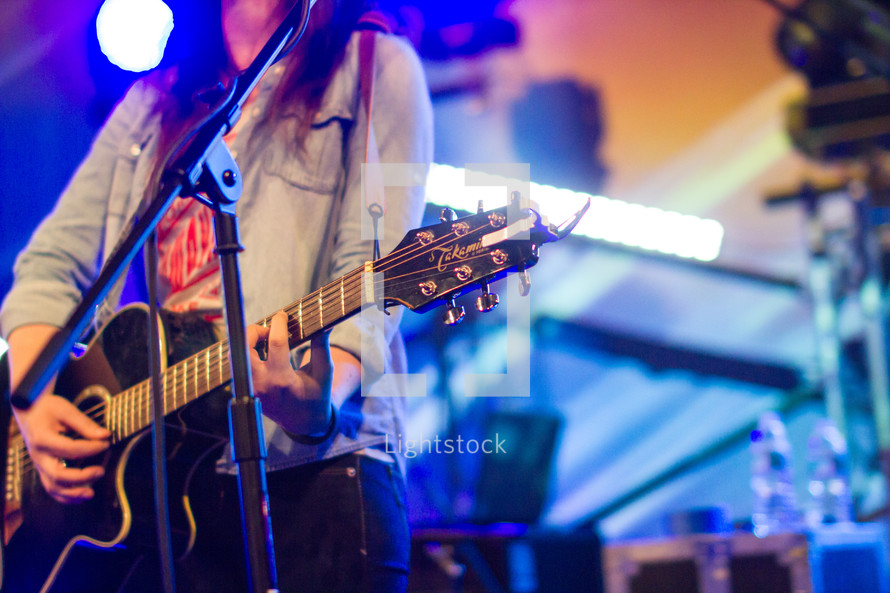 Guitar player on stage.