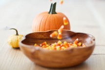 filling a bowl with candy corn