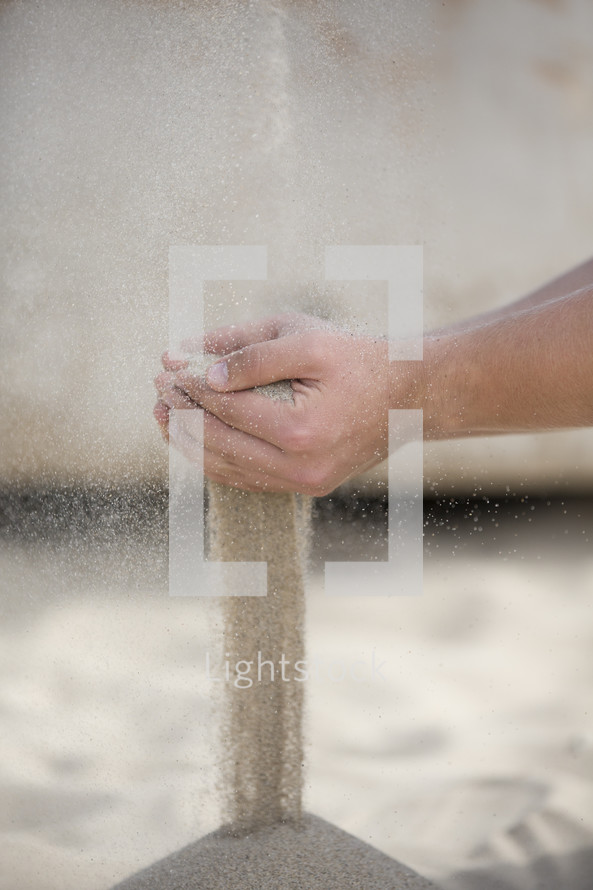 filtering sand through your hands