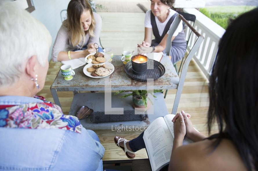 Praying women at a Bible study.