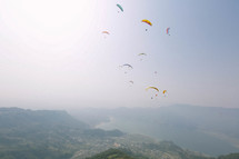 parachuters over a valley