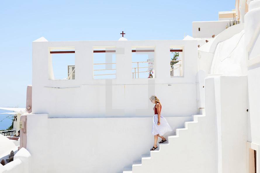 woman walking down steps in Greece