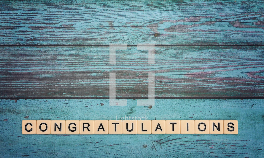 Congratulations in scrabble pieces on a teal background