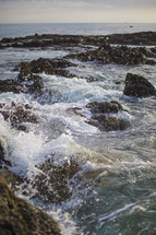 sea rocks and splashing water