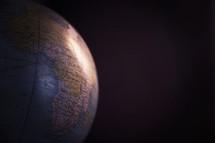 globe against a black background