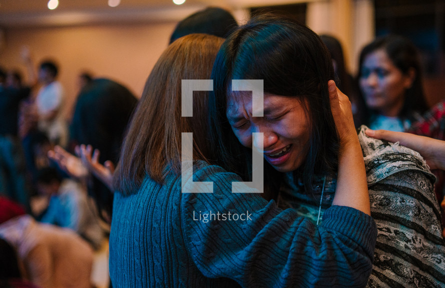 hugs and tears at a worship service