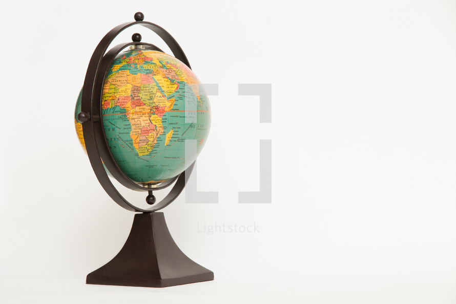 Old globe against a white background
