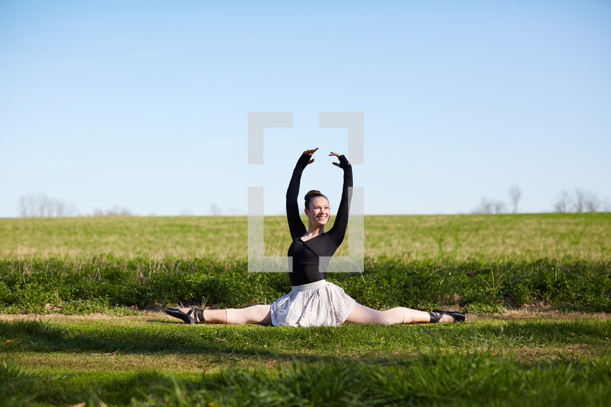 a ballerina in a field