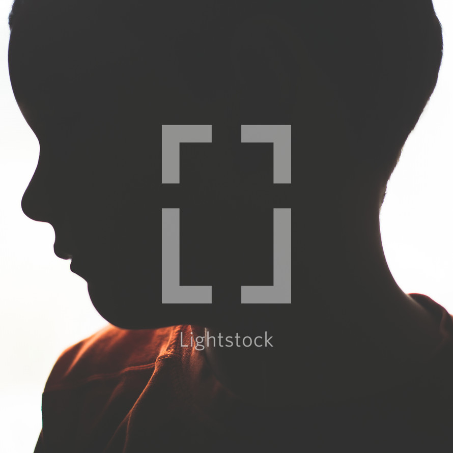 silhouette of a boy child