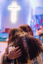 hugs during a worship service