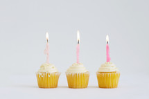 flames on candles on a birthday cupcake