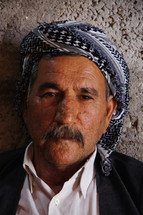 Elderly Kurdish Man in traditional headdress. [For similar images search for Ethnic Faces]
