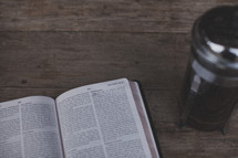 An open Bible and french press