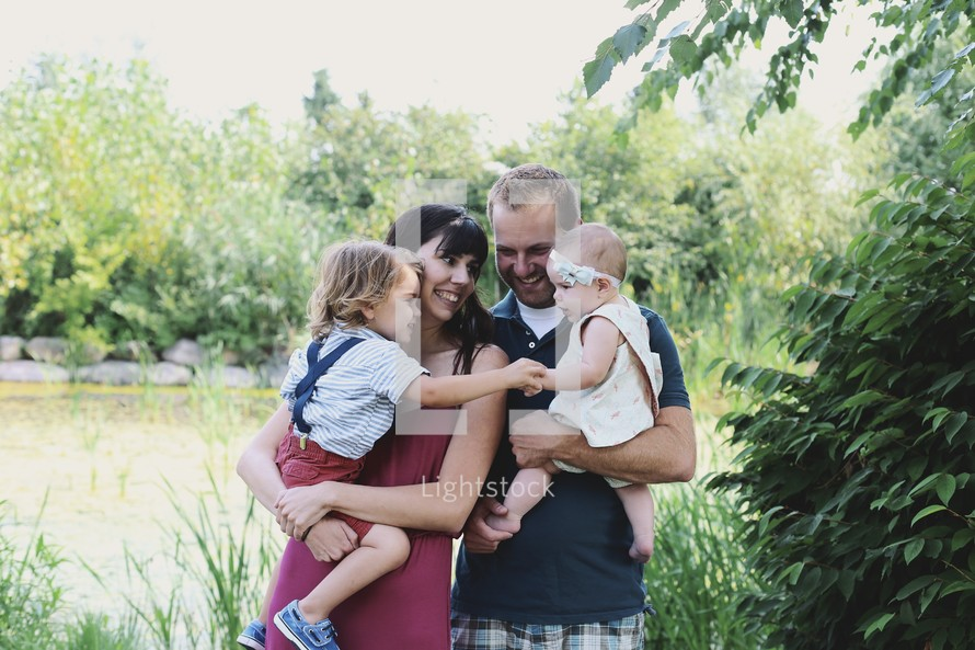 a happy family with young children