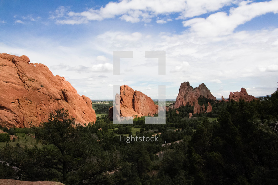 red rock peaks and forest