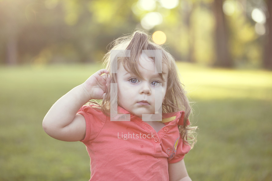 toddler girl with messy hair