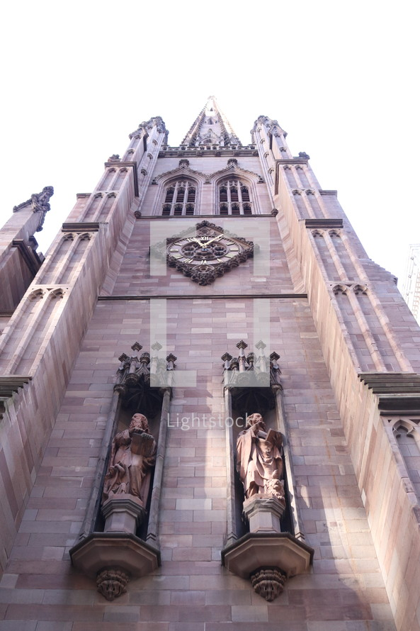 looking up at a cathedral exterior walls
