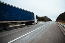 18-wheel cargo truck on a road.