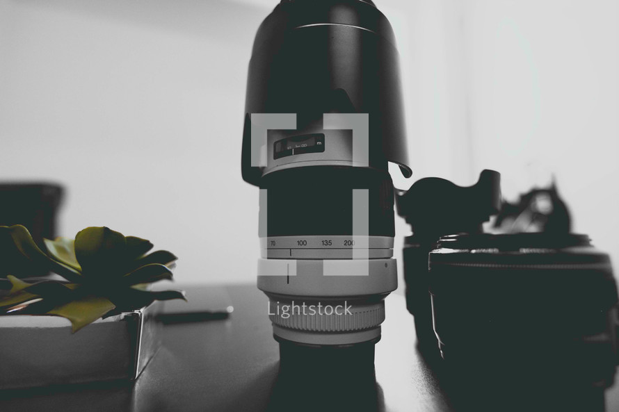 camera lenses on a table