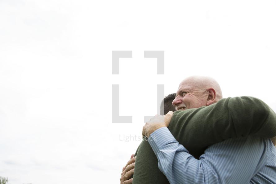 men hugging in greeting