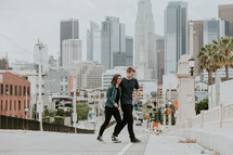 couple walking in a city with palm trees