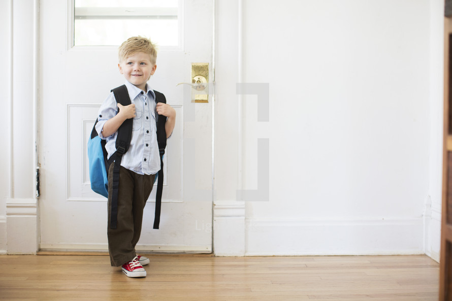 boy child standing at a door - first day of school