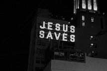 Jesus saves sign in a city at night