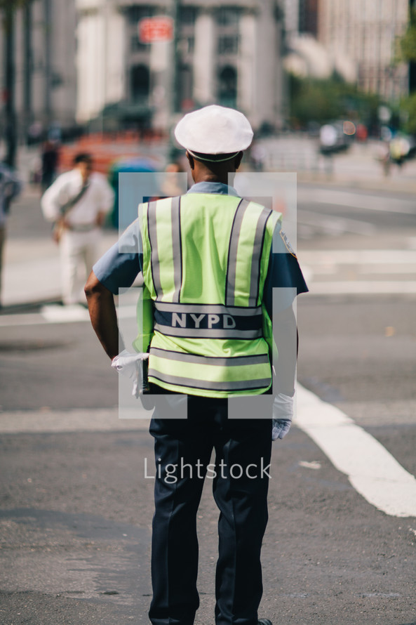 NYC police office directing traffic