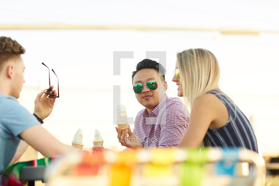 friends eating ice cream cones outdoors