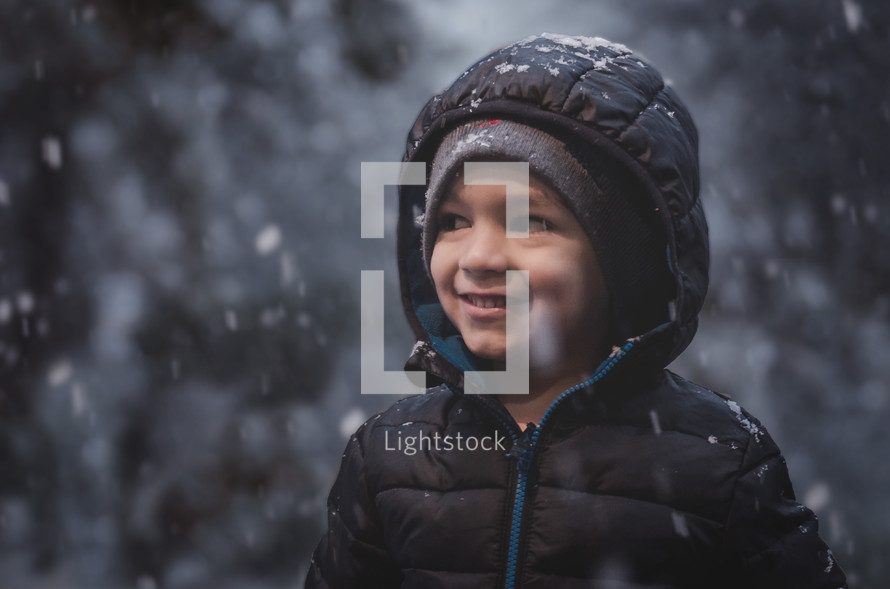 a kid in falling snow