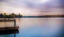 Beautiful autumn colors contrast a purple sky on a lake. (3o second exposure)