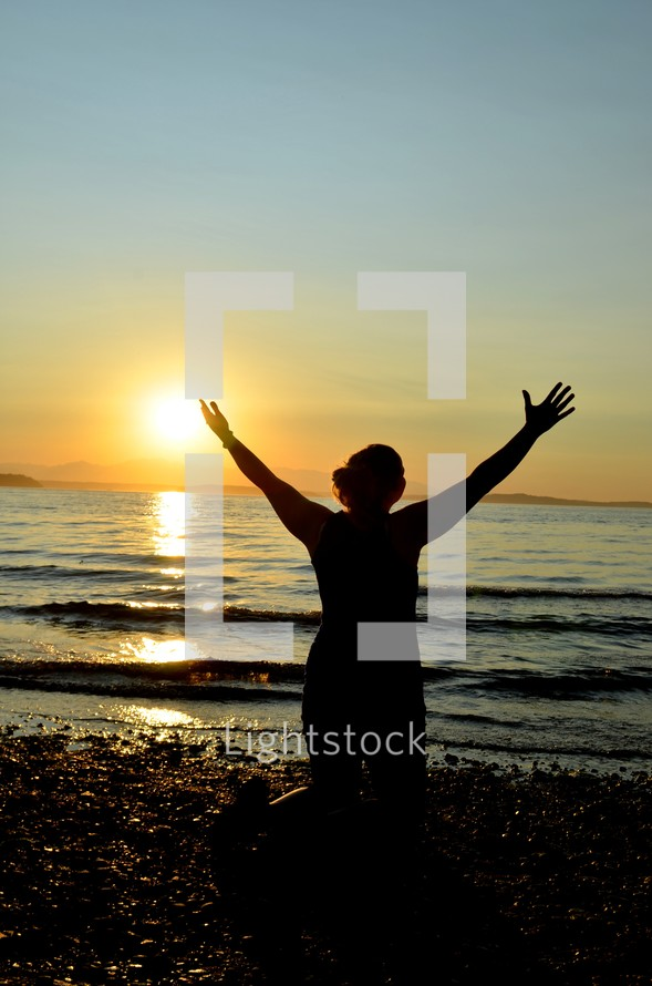 woman with raised hands in praise to God