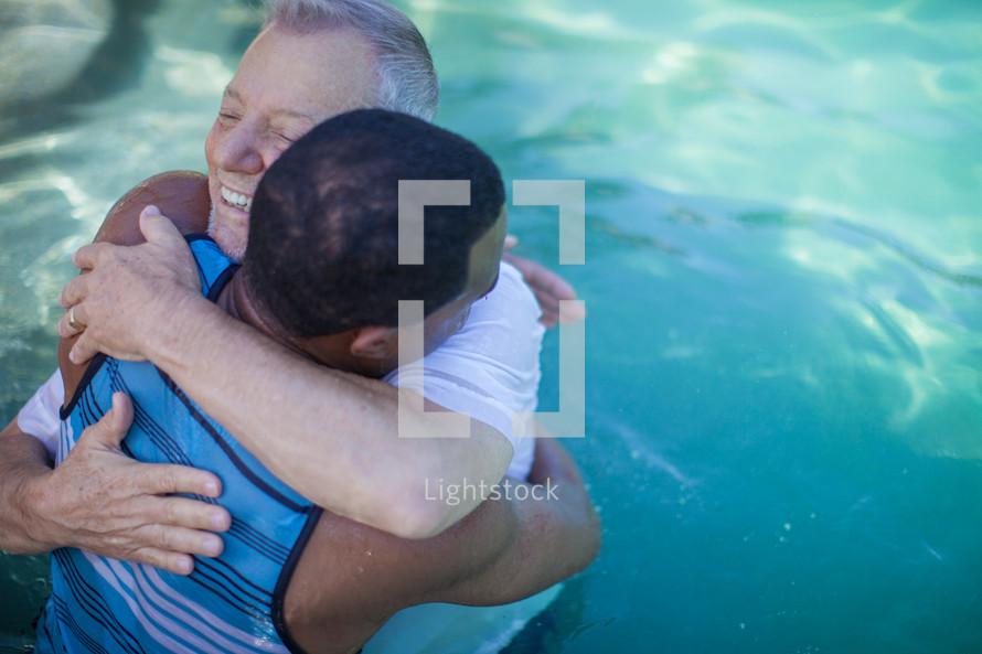 hugging after a baptism