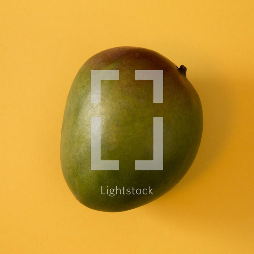 mango on yellow