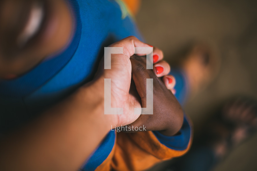 child and missionary holding hands