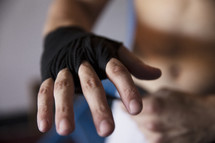 boxer putting on his boxing gloves