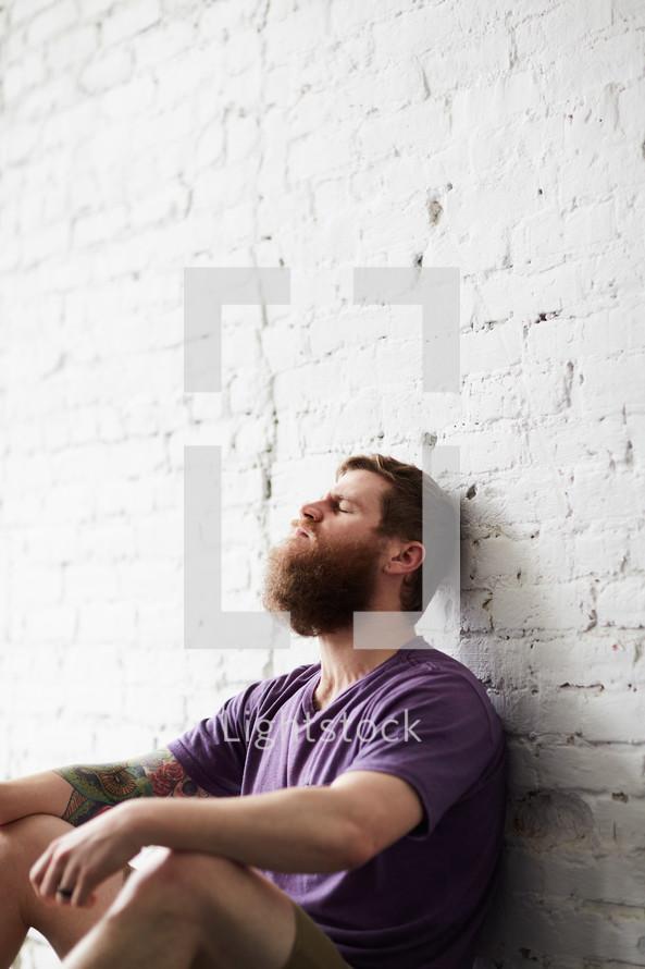 a stressed man sitting alone