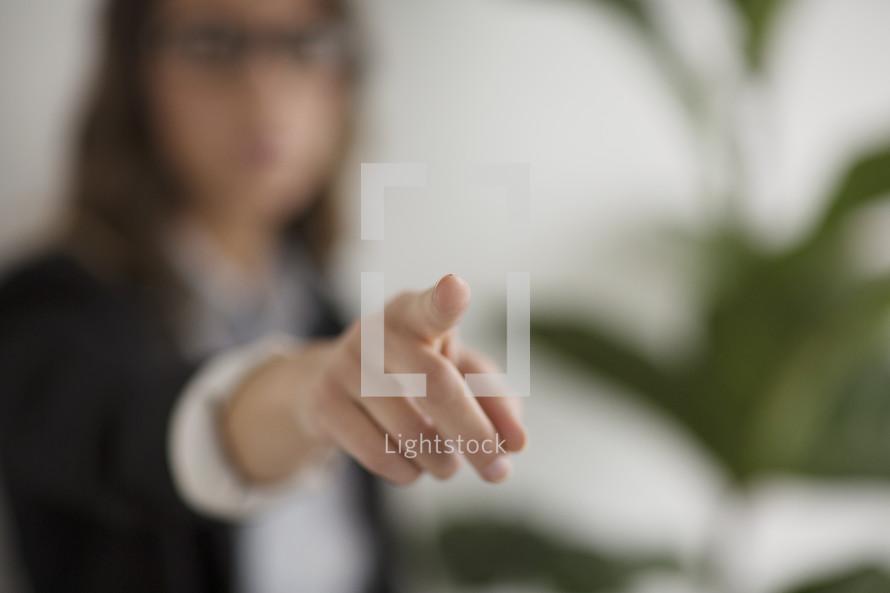 a woman pointing her finger