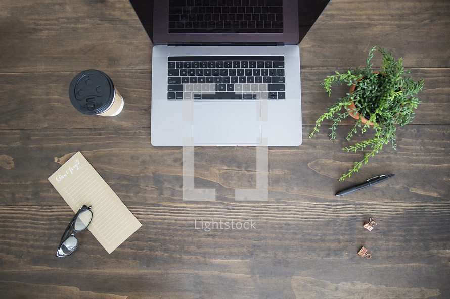laptop on a wood desk with copy space