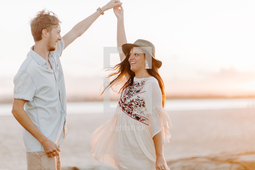 a couple dancing on a beach